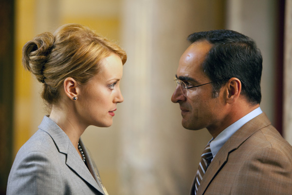 Photo of Taylor Schilling as Dagny Taggart and Navid Negahban as Dr. Robert Stadler